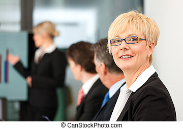 Business - presentation within a team; a female, colleague...