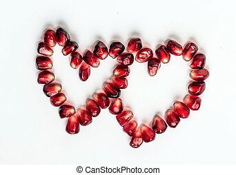 hearts of pomegranate seeds - two hearts shape made up of...