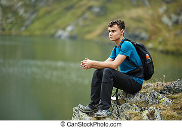 Hiker boy by the lake