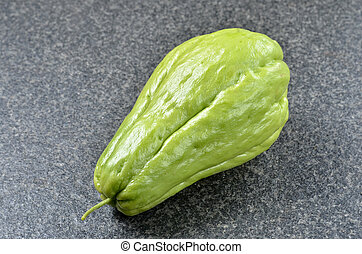 Chayote isolated on black background