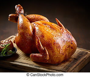 roasted chicken on wooden cutting board