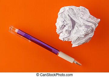 paper ball and pen