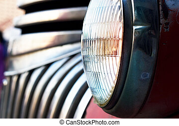Colorful head light vintage car on dark tone, soft focus and...