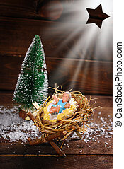 Jesus Christ is born - symbolic nativity scene with baby...