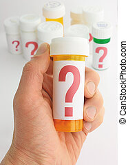 Questions about Medicine - closeup of a hand holding a...