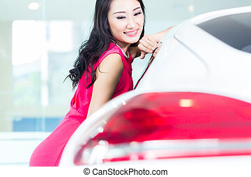 Asian Chinese woman buying SUV car