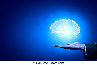 Mental health - Close up of human hand holding brain on blue...