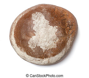 A loaf of fresh bread covered with rye flour in the shape of...