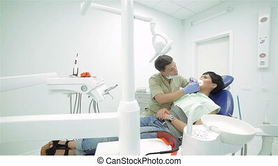 Dentist teeth ending inspection patient view general - Young...