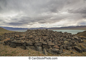 A pile of stones on the lake Uureg Nuur in Mongolia - A pile...