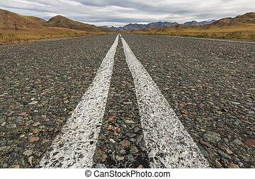 Asphalt road in the highlands
