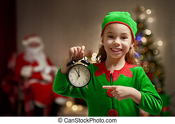 Christmas elf - Happy child in Christmas elf costume with...