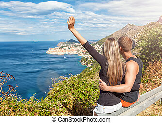 Happy couple enoying the view of Dubrovnik on their travels...