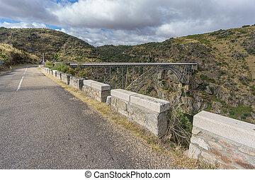 Road to Requejo iron Bridge, Castile and Leon, Spain - Wide...