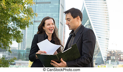 Two business people looking at papers
