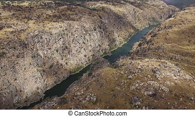 Aerial view descending camera to cliff in Duero River, Spain...