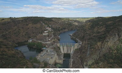 Flying over dam in canyon - Aerial view, flying over dam in...