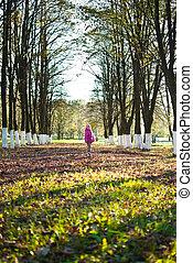 girl walks in the park