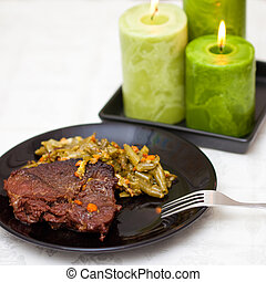 Candlelight dinner. Meat steamed - Meat steamed with with...