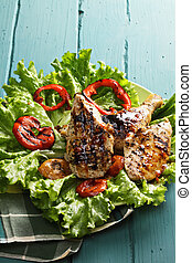 Grilled chicken breasts and leg on lettuce - Grilled chicken...