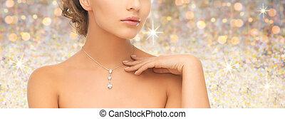 woman wearing shiny diamond pendant - people, jewelry,...