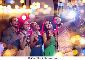 friends with glasses and smartphone in club - party,...