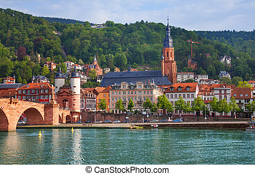 View of Alte Brucke bridge and Neckar river in sunny...
