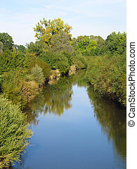 Odra river flowing through the forests in early autumn...