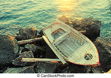 old wooden boat at a Mediterranean seaGreece - old wooden...