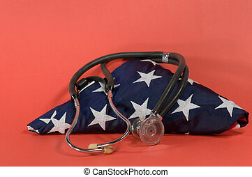 america health - stethoscope on folded US flag with red...