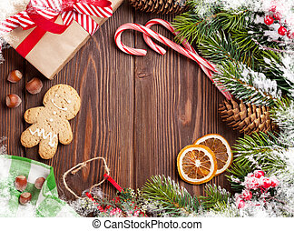 Christmas wooden background with snow fir tree, decor and...