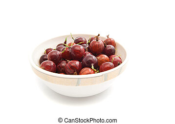 some gooseberries on a glass dish - tasty red gooseberries...