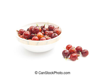 red gooseberries on a glass dish - red gooseberries on a...