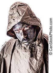 Poncho soldier - a soldier wearing a poncho or raincoat and...