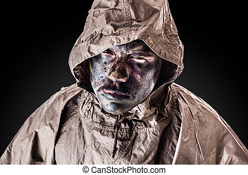 Grungy soldier - a soldier wearing a poncho or raincoat and...