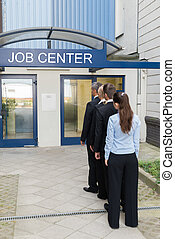 Businesspeople Outside The Job Center - Group Of...