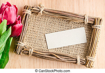 tulips with a card on a woode - Tulips with a card on a...