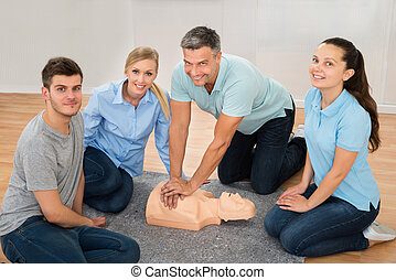 Instructor Showing Cpr Training On Dummy