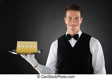 Waiter With Star Rating Board - Portrait Of Happy Waiter...