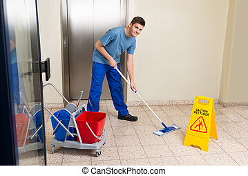 Male Janitor Mopping Floor - Happy Male Janitor With...