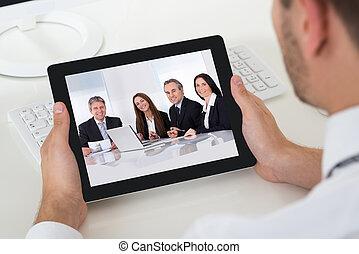 Businessman Videoconferencing With Digital Tablet - Close-up...