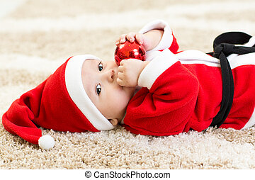 Baby boy weared Santa hollding christmas ball - Baby boy...
