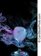 Blue and purple smoke in the glass. Halloween. - Abstract...
