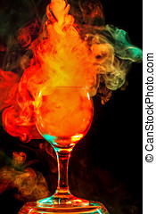 Orange smoke in a glass. Halloween. - Abstract art. Hookah...