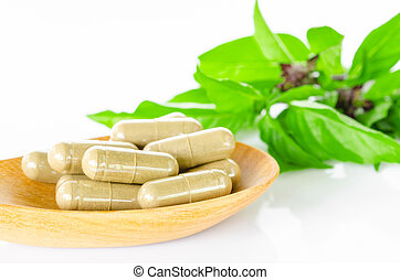 Yellow herbal capsule medicine drug. - Yellow herbal capsule...