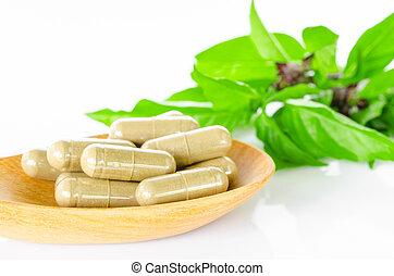 Yellow herbal capsule medicine drug. - Yellow herbal capsule...