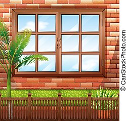Side of building with brick wall and window