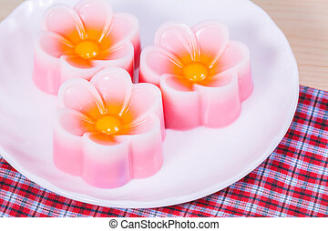 Thailand tradition ,Flower Dessert Coconut Jelly on wood...