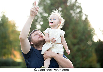 Father and daughter - Portrait of happy dad and toddler...