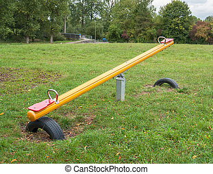 Seesaw - outdoor playground scenery with Seesaw, lawn and...